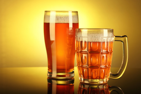Two Beer Mug  Glass with froth with reflection