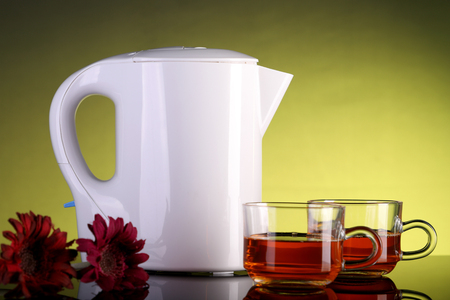 Electric Kettle and Two Tea Cups with Flowers