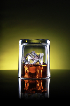Whisky Glass Upside Down with Ice Cubes Standard-Bild - 119986130