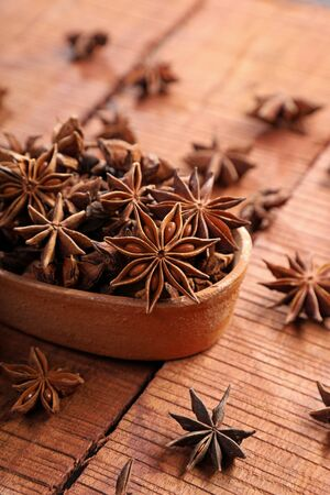 Organic Indian Spice  Herb Star Anise in a Brown Bowl Фото со стока