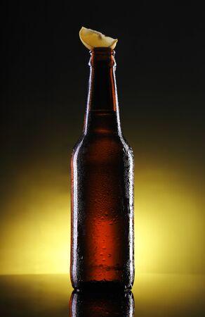 Beer Bottle Mockup with Lemon on Top Фото со стока