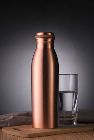 Copper Water Bottle and Glass of Water for Environment Friendly Use