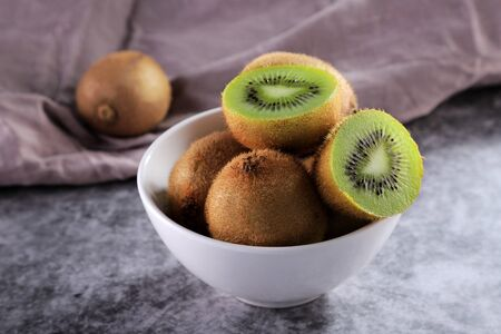 Organic Healthy Kiwi Fruit in a White Bowl