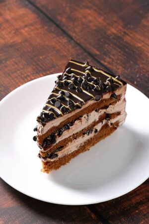 Dessert - A Sweet Cake Slice with Chocolate Chips and Cream