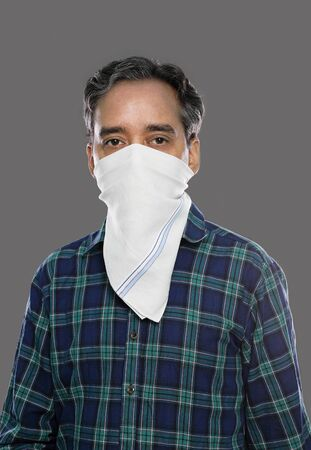 Indian Man with Handkerchief Mask for Covid-19 / Coronavirus Prevention