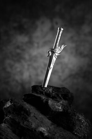 King Arthur's Sword - Excalibur in Black Stone Standard-Bild