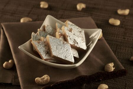 Delicious Indian Sweet Kaju Katli in a White Bowl
