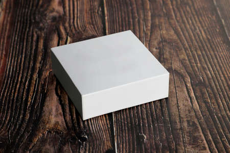 Clean White Blank Product Packaging Box for Mock ups on Wooden Background Standard-Bild