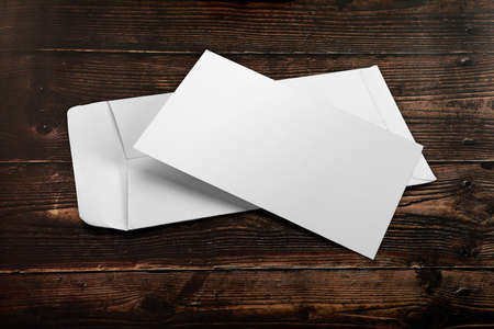 Blank White Envelope Mockup with an Invitation Card on Wooden Background