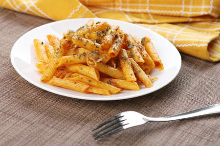 Penne Pasta Food Plate with a Fork on Wooden Tray Standard-Bild