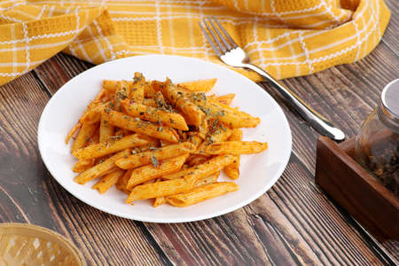 Food - Tasty Penne Pasta Plate with a Fork on Wooden Table