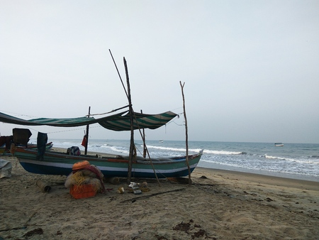 maharashtra: Fishing boat parked on a beach in the morning hours. Stock Photo