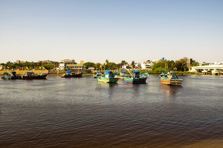 Many fishing boats in Daman Ganga river at Nani Daman Jetty in Daman, India