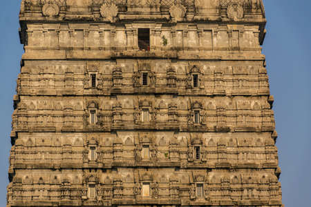Close-up of sunlit beautiful design on the world's tallest gopura or gopuram of a Hindu temple in Murdeshwar Temple complex which is located on the West Coast of India at Murdeshwar, Karnataka, India