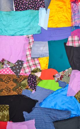 Different Multi colored fabrics background Stock Photo