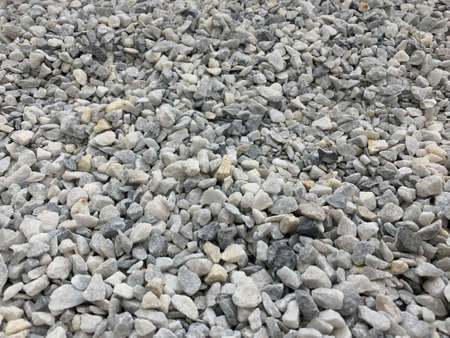 gray small granite chips, building material, simple background. use in various fields Banco de Imagens