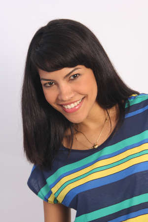 Beautiful young, black-haired Latino in a striped shirt with a pretty smile