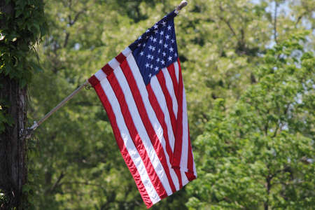 American Flag  Stars   Stripes  gently hanging limply from a pole