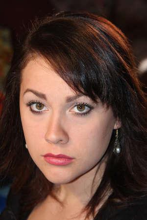 Lovely young brunette after applying make-up