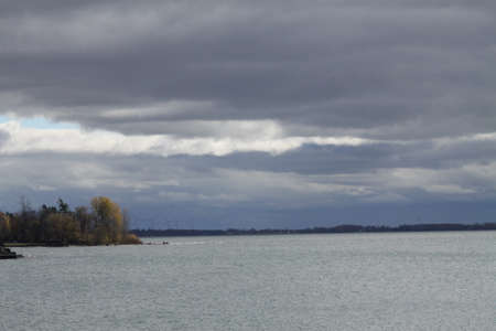 Sky and clouds meet water, overcast afternoon, some sunny periods.