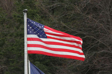 stars and stripes: American Flag Stars  Stripes gently waving in a light breeze on top of a pole. Stock Photo