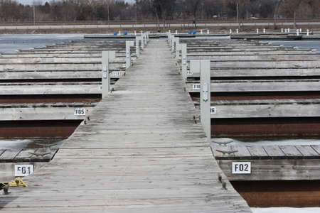 Wooden deck leading to empty boat slips.