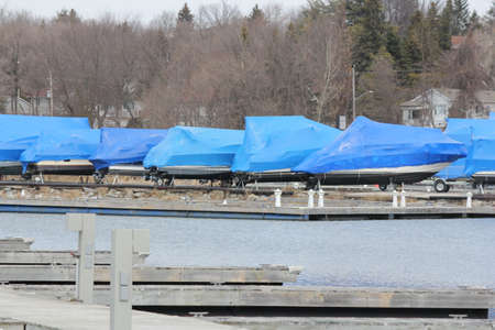 shrink: Boats with a covering of shrink wrap for protection from the winter weather in North America Stock Photo