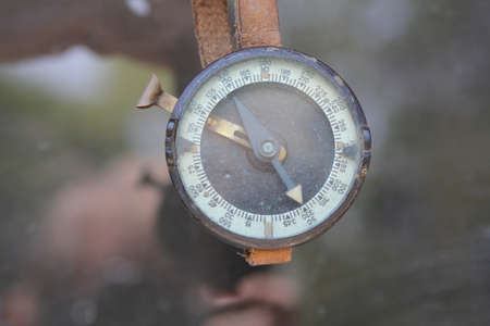 commando: Old Military compass hanging on leather strap