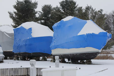 Shrink wrap on boats, on dry land during the winter season as protection against elements.