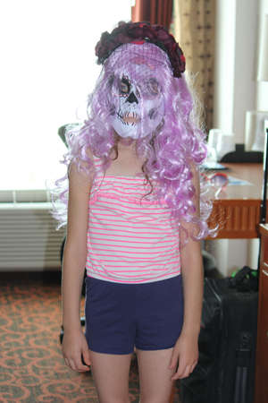 Young girl getting ready to go trick or treating for Halloween. Stock Photo