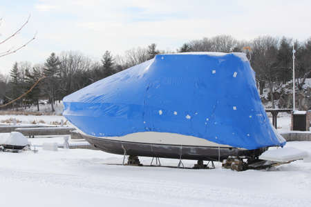 Plastic shrink wrap on boat, to protect boat and interior of boat from the winter elements.