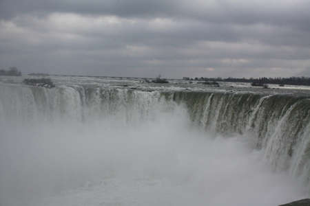 Mist almost completely covering the Horseshoe Falls in Niagara Falls on a cold, overcast, winter afternoon.