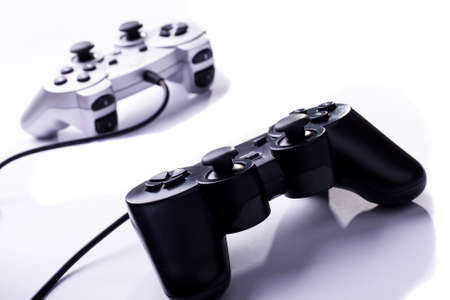 two gamepads black and white with wires on white background
