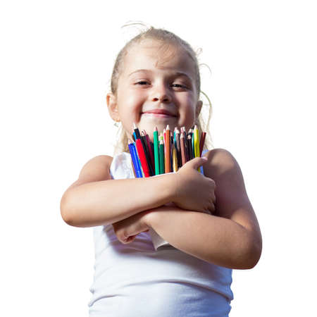 cute little girl with pencils smiling to the camera isolated on a white Фото со стока