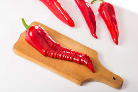 capa red pepper on a kitchen board on a white background