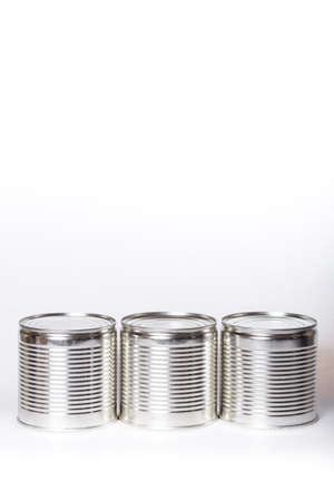 Three sane metal cans with preservation on a white background Stock fotó