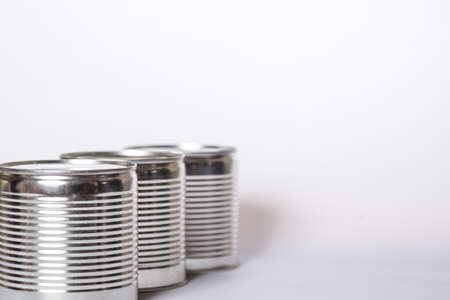 Three metal cans on a white background with copy space Stock fotó