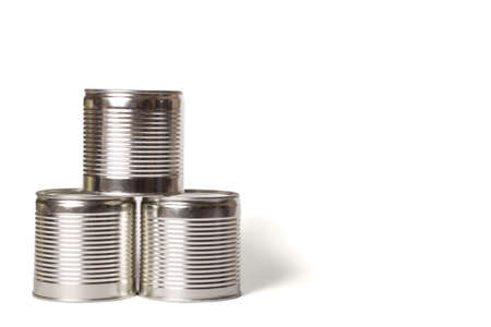 Three metal cans without labels isolated on a white