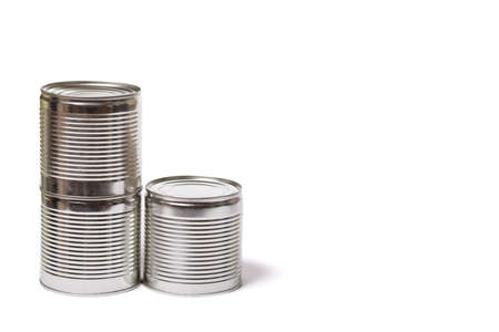 Metal cans with conserved vegetables on a white background with copy space.