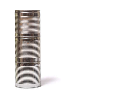 Metal cans on each other on a white background, with copy space.