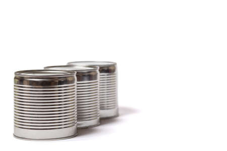 Three metal cans with food isolated on a white background.