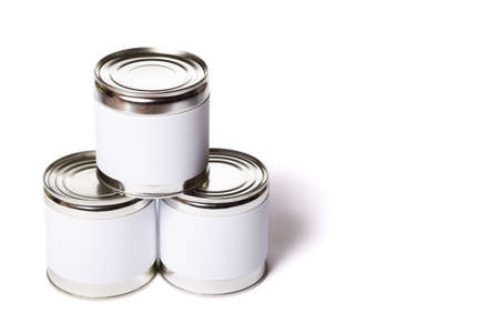 Three metal cans with no lable isolated on a white background.