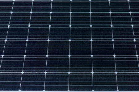 Dirty real solar panels in the power station, close up.