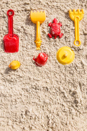 Sand box with different toys with copy space. Playgpund for children on sand box. Banque d'images