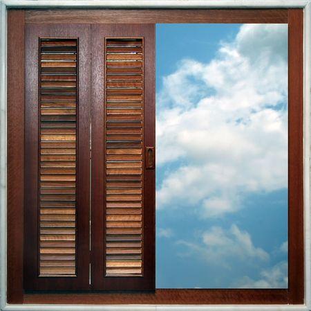 overlooking: A half-open window, overlooking the sky.