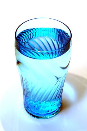 filled: A blue-tinted glass filled with drinking water