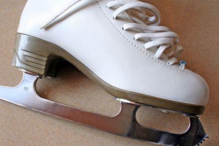 glide: A white skating boot Stock Photo