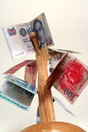 Major asian currencies arranged on a wooden pole. photo