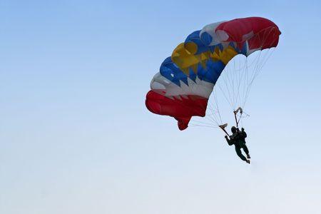 A parachutist on his way down. Stock Photo