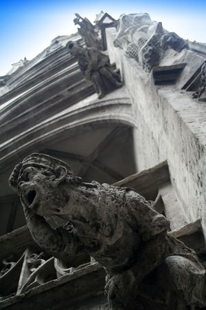 Gargoyles adorning the exterior of an old church building in Munich, Germany. photo